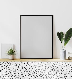 Moldura vertical de pôster preta na mesa de madeira simulada com parede branca, folhas e plantas, estilo escandinavo, renderização em 3d