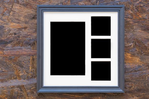 Molduras para fotos em plano de fundo texturizado de madeira