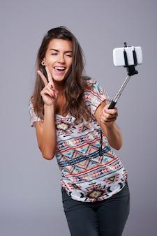 Monopé como um recurso muito útil para tirar uma selfie