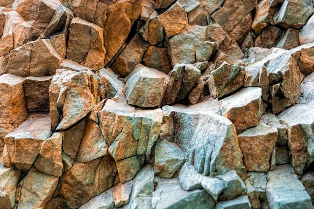 Montanhas abstratas texturizam basalto vulcânico como na islândia textura de rocha colorida e brilhante