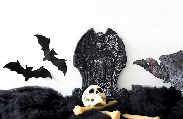 Morcegos e abutre no cemitério