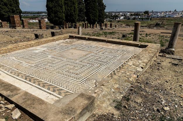 Mosaico antigo nas ruínas romanas de itálica