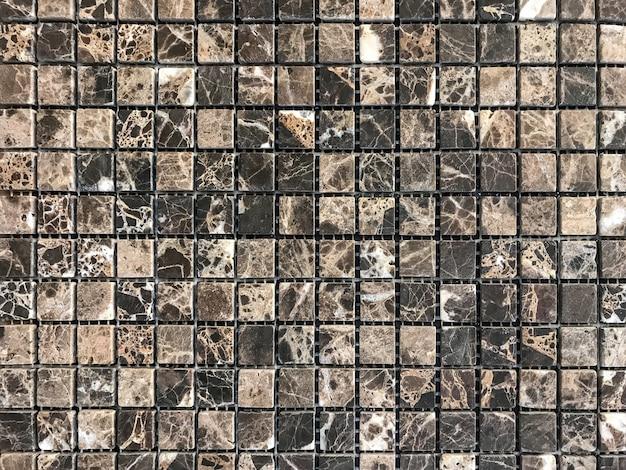 Mosaico de azulejos de pedra cinza para decoração do banheiro e piscina.