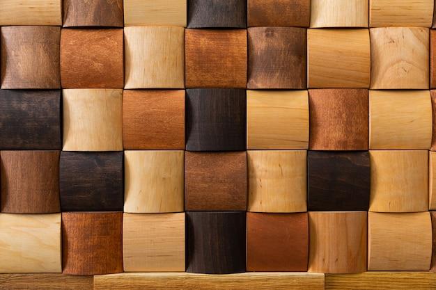 Mosaico de madeira closeup, decoração da parede. design moderno, textura de madeira natural