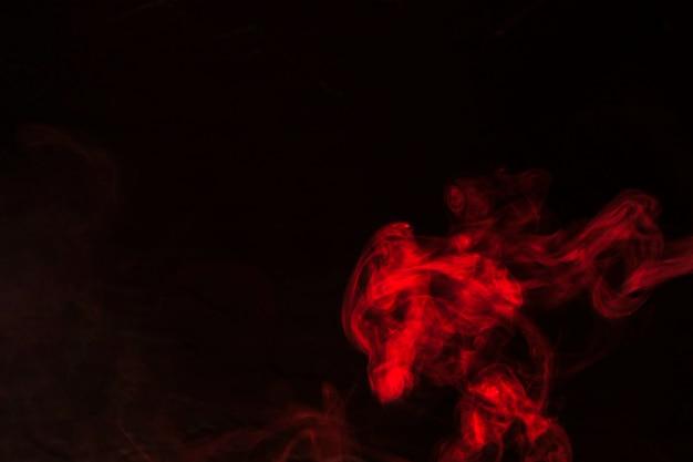 Movimento de textura de sobreposição de fumaça vermelha em fundo preto