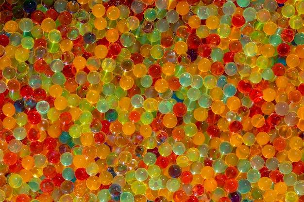 Muitas bolas de hidrogel de cores diferentes conjunto de orbis multicoloridos para fundos ou texturas