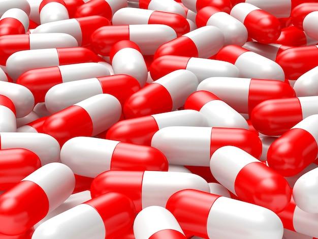 Muitas cápsulas médicas vermelhas e brancas