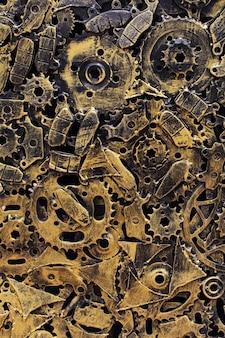 Muitas engrenagens de metal enferrujadas velhas ou peças de máquinas
