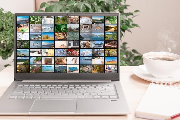 Muitas imagens diferentes em streaming de vídeo na tela do laptop. vídeo digital e conceito de mídia móvel