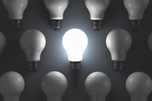 Muitas lâmpadas em uma linha de produção. uma das luzes está acesa