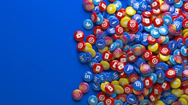 Muitas pílulas brilhantes de redes sociais multicoloridas em 3d sobre um fundo azul