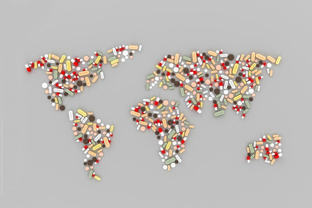 Muitas pílulas espalhadas sobre a mesa na forma de mapas mundo