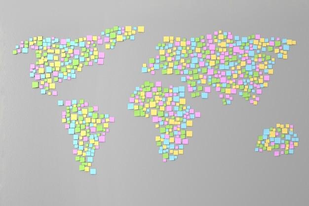 Muitos adesivos colados na parede em forma de silhuetas de continentes ilustração 3d