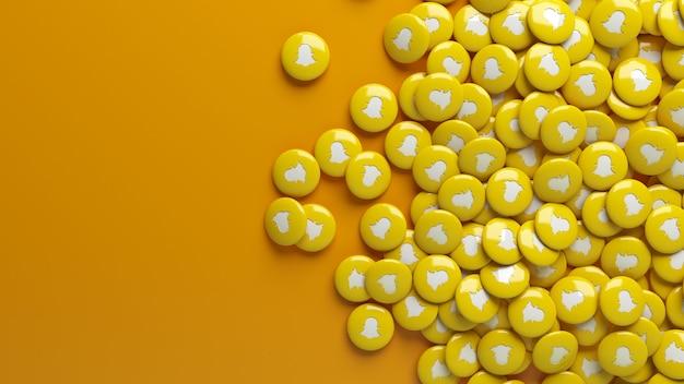 Muitos comprimidos de snapchat sobre uma laranja sólida