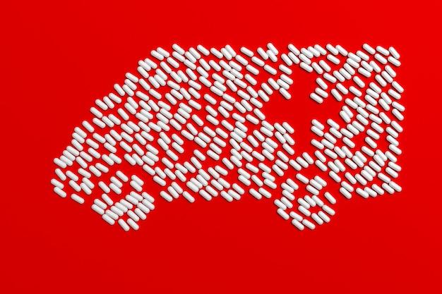 Muitos comprimidos desintegrados na forma de uma ambulância em um fundo colorido. ilustração 3d