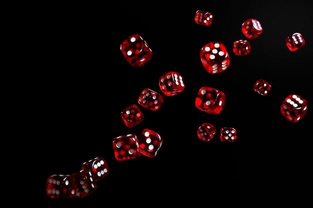 Muitos dados vermelhos voando sobre fundo preto. conceito de jogo.