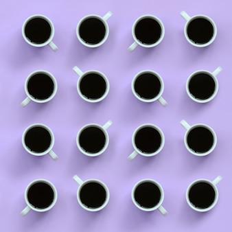 Muitos pequenos copos de café branco sobre fundo de textura