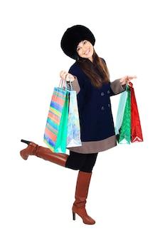 Mulher bonita com sacolas de compras
