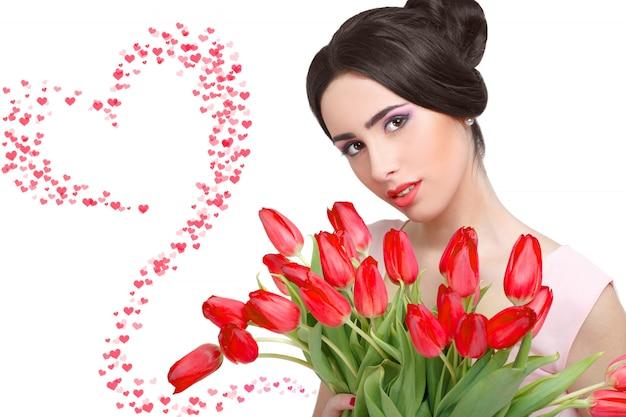 Mulher com buquê de tulipa