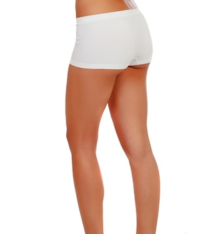 Mulher com calcinha branca e bunda firme