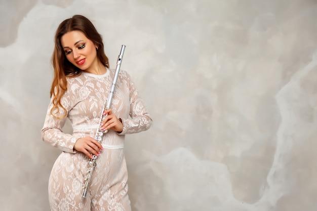 Mulher com flauta
