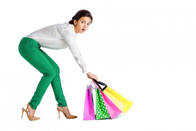 Mulher com sacolas de compras