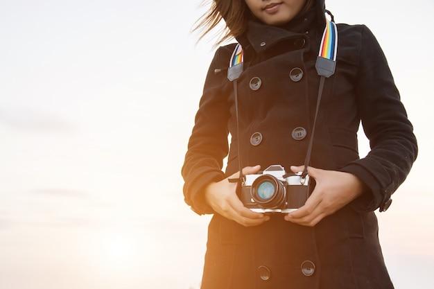 Mulher com uma câmera
