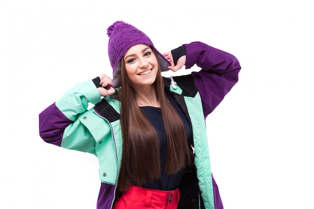 Mulher de beleza no cabelo longo de traje de esqui
