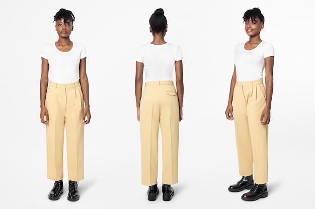 Mulher de camiseta branca e calça casual bege, moda corpo inteiro