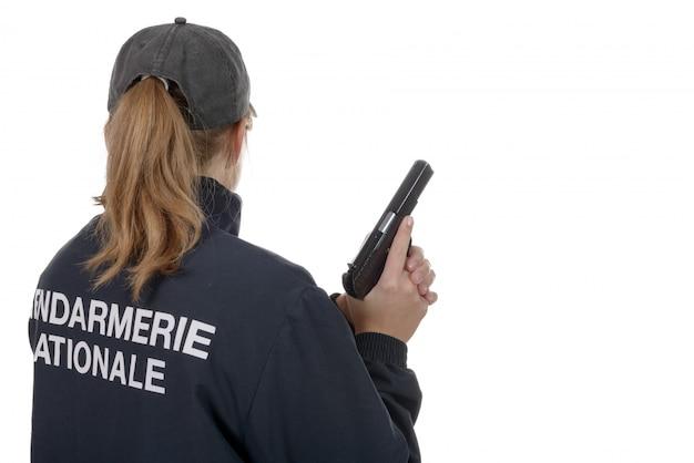 Mulher de gendarme vista traseira isolada no branco