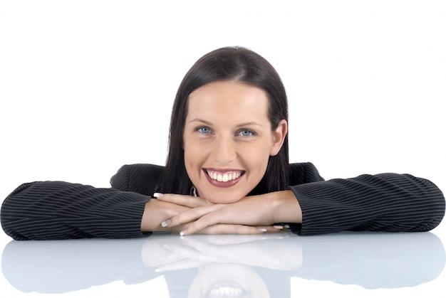Mulher de negócios apoiado em uma mesa