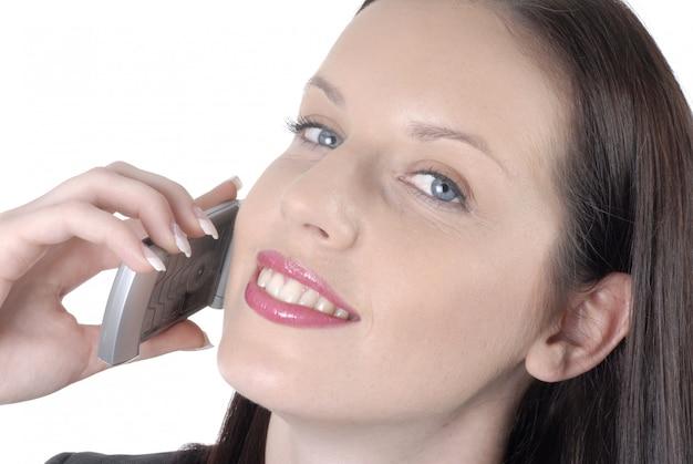Mulher de negócios atraente com celular