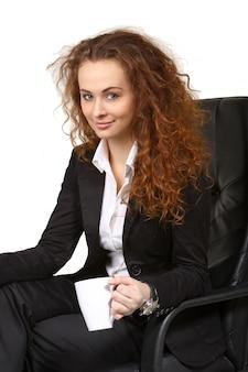 Mulher de negócios com uma xícara de chá