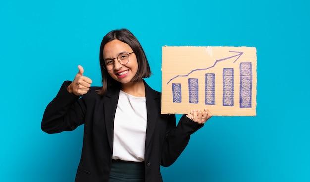 Mulher de negócios jovem e bonita com um gráfico de barras crescente