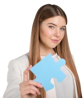 Mulher de negócios, segurando a peça do quebra-cabeça