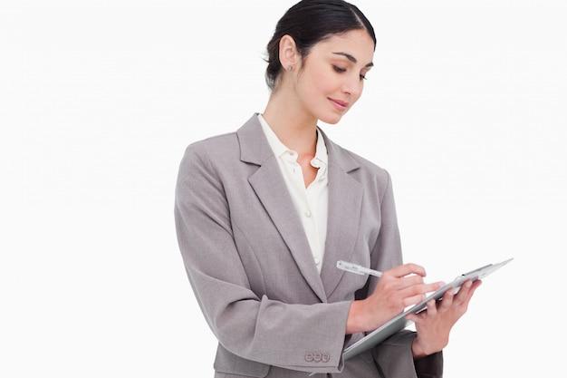 Mulher de negócios tomando notas