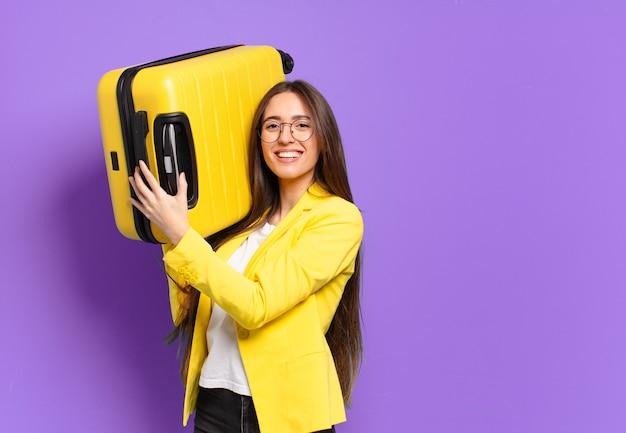Mulher de negócios young pretty com uma mala