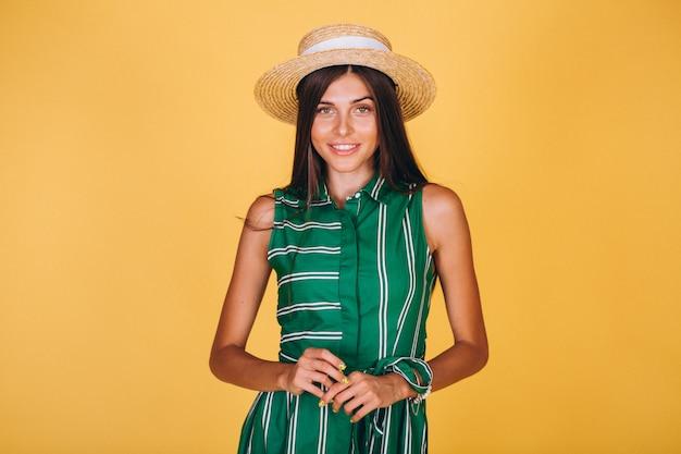 Mulher, em, vestido verde, e, chapéu, ligado, experiência amarela