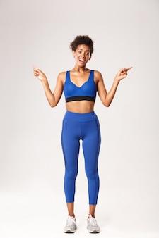 Mulher expressiva em roupas de fitness posando