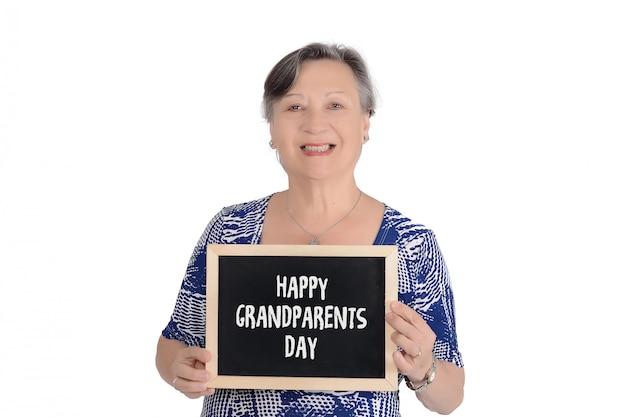 Mulher idosa, segurando, lousa, com, texto