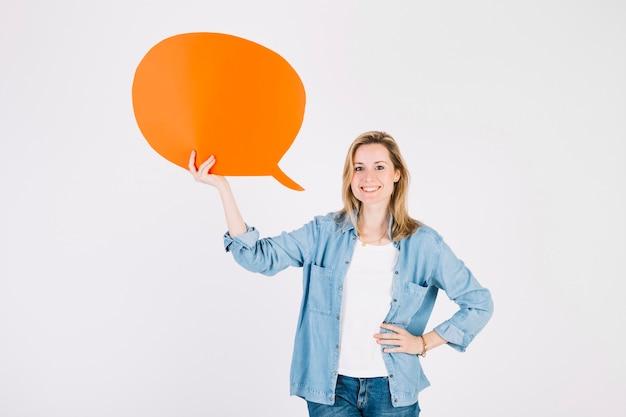 Mulher jovem, com, laranja, fala, bolha