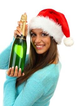 Mulher jovem e bonita com garrafa de champanhe, isolada no branco