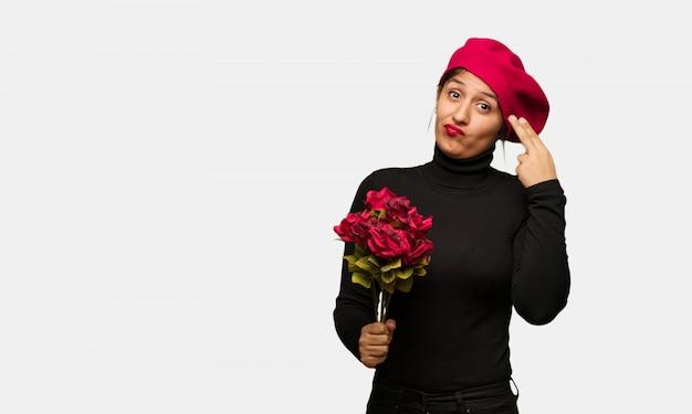 Mulher jovem, em, dia dos namorados, fazendo, um, gesto suicídio