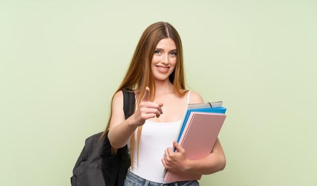 Mulher jovem estudante aponta o dedo para você