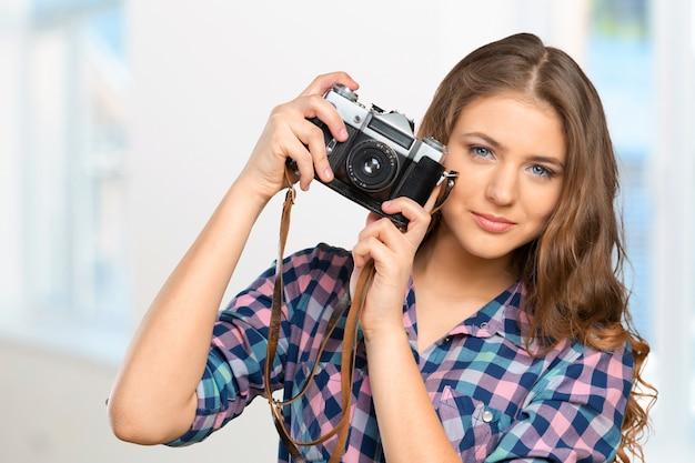 Mulher jovem, segurando, câmera