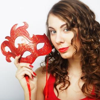Mulher jovem, segurando, máscara vermelha
