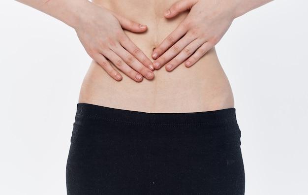 Mulher magro, cintura estreita preta legging caloria dieta costelas. foto de alta qualidade
