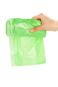 Mulher, mãos, segurando, saco lixo, isolado, branco