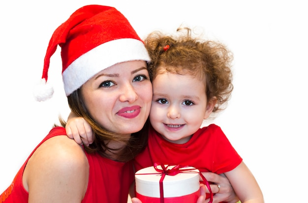 Mulher, menina, senhora de chapéu de papai noel dar presentes, surpresa para o bebê para o ano novo, natal.