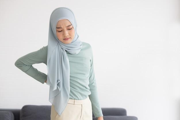 Mulher muçulmana com doença